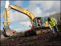 Landmover and workman on the site