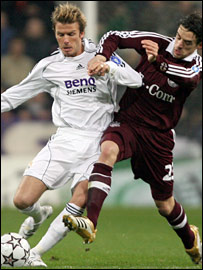 David Beckham (left) tangles with Owen Hargreaves