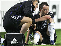 John Terry receives treatment before being stretchered off