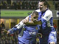 Wigan scorer Caleb Folan (left) celebrates with Lee McCulloch
