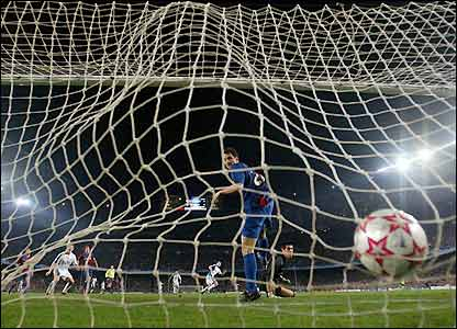 The ball ruffles the back of the Barcelona net