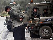 Palestinian showing papers at Israeli roadblock