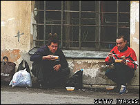 Homeless men eating soup in St Petersburg