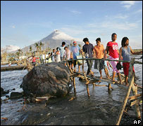 Villagers displaced by mudslides near Mayon volcano, 320 km south of Manila