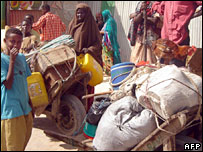 Mogadishu residents pile their belongings on push-carts as they join a mass exodus triggered by spiralling violence in Somalia's capital on Wednesday