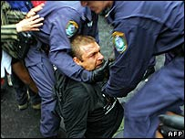 Protester is arrested by police in Sydney during demonstrations on Thursday over Dick Cheney's visit - 22/02/07