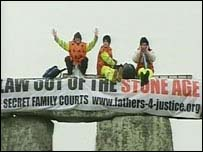 Protesters on top of the stones