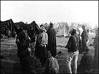 Armenian refugees attend a burial in a deportation camp 1915 (picture taken by German photographer Armin Wegner; reproduced here by permission of the Armenian National Institute)