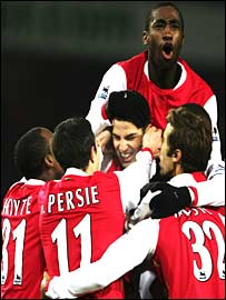 Johan Djourou celebrates with a host of Arsenal's young stars, including Justin Hoyte, Cesc Fabregas and Theo Walcott