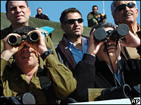 Mr Peretz (right) looks through the capped binoculars