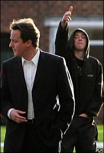 A youth gestures at David Cameron during a trip to the Benchill area of Wythenshawe , Manchester