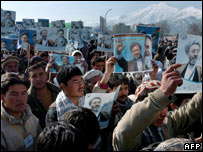 Protesters hold up placards at the stadium demonstration in Kabul, Afghanistan