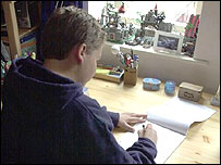 Boy writing at his desk