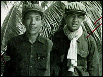 Ex Khmer Rouge security service chief Kang Kek leu, known as Duch (left), with his aid Sok in 1976 - handout photo