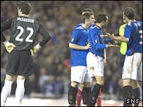 Rangers remonstrate with the referee as Allan McGregor is sent off