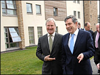 Dr Brian Lang (L) with Gordon Brown (R)