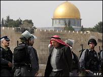 A Palestinian man passes Israeli security near the al-Aqsa mosque