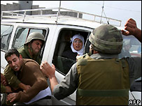 A Palestinian man is arrested in Ramallah, West Bank