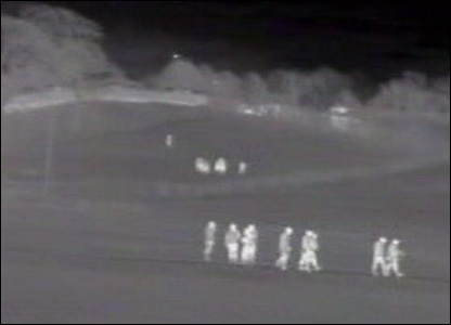 Black and white footage of the rescue effort