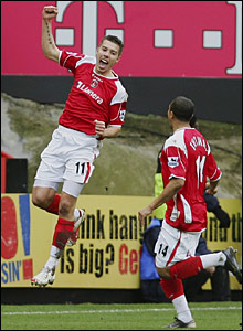 Darren Ambrose celebrates after turning in Marcus Bent's cross to get Charlton off the mark