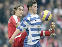 Jonathan Woodgate and Reading's Shane Long