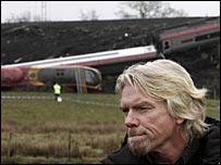 Sir Richard Branson surveys the train crash