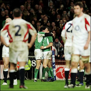 Shane Horgan and Ronan O'Gara celebrate Ireland's third try