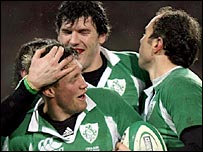 Ronan O'Gara (left), Shane Horgan and Girvan Dempsey celebrate