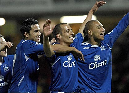 Tim Cahill, Leon Osman and James Vaughan celebrate Osman's goal