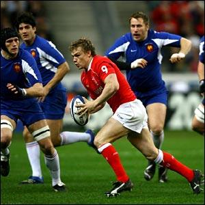 Wales scrum-half Dwayne Peel breaks early in the game