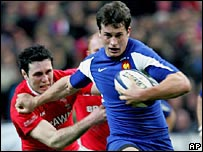 France centre Yannick Jauzion powers past Wales captain Stephen Jones