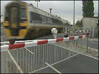 Train at a level crossing
