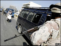 An Iraqi soldiers mans a checkpoint in Baghdad on 21 February 2007
