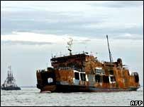 Tug towing Levina I ferry