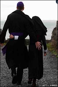 Couple dressed as a priest and a nun