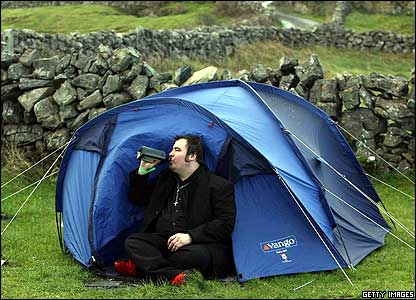 Man drinking in a tent