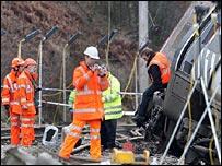 Investigators inspecting the wrecked train