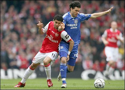Arsenal's Denilson and Chelsea's Michael Ballack contest possession