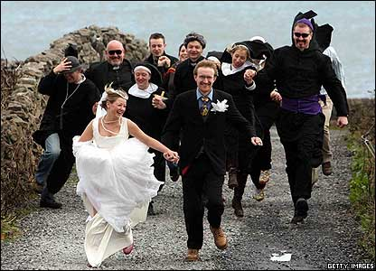 Louise Kiernan and Luke Callanan run after their druid wedding ceremony