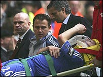 John Terry is carried away on a stretcher