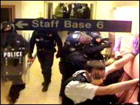 Riot police enter a hospital