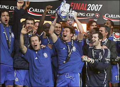 Frank Lampard, deputising for John Terry, holds the Carling Cup aloft for Chelsea