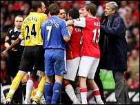 Arsenal boss Arsene Wenger (right) tries to break up the brawl