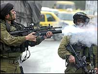 Israeli soldier fires tear gas in Nablus