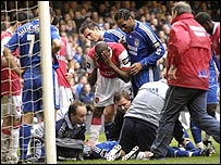 John Terry is tended to in the Carling Cup final
