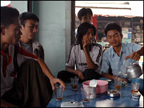 Burmese migrants pouring tea in an Burmese-style teashop
