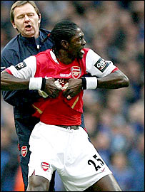 Arsenal striker Emmanuel Adebayor had to be dragged off the pitch after he was sent off