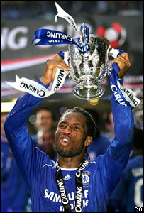 Chelsea's match-winner Didier Drogba with the trophy