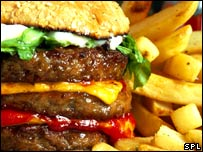 A triple burger and French fries