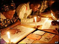 Election workers in Senegal count votes by the light of candles